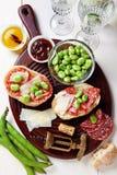 Italian snacks. salami sandwich Royalty Free Stock Photography