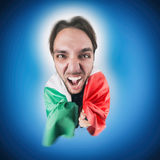Italian soccer Fan holding the flag of Italy. Excited and happy for his team Stock Images