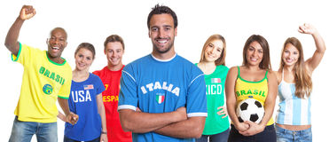 Italian Soccer Fan With Crossed Arms And Other Fans Stock Images