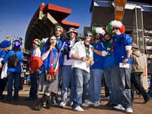 Italian Soccer Supporters - FIFA WC. Soccer fanatics, supporting Italy, dressed up in fancy dress costume, with their faces painted in the colours of the flag Royalty Free Stock Photography
