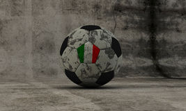 Italian soccer washed-up ball on concrete background Royalty Free Stock Photo