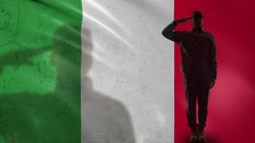 Italian soldier silhouette saluting against national flag, proud army officer. Stock footage stock video