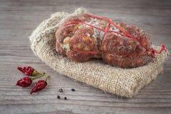 Italian Soppressata. Tasty italian Soppressata ham on wooden background royalty free stock photos