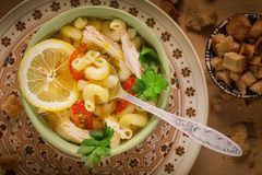 Italian soup with pasta and chicken stock photo