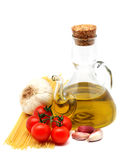 Italian spaghetti. Olive oil, garlic and tomatoes, a tipical seasoning for italian spaghetti Stock Images