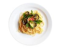 Italian Spaghetti And Aubergine. Traditional Italian cuisine. Pasta or spaghetti (alla norma) with aubergine, fresh tomatos and parsley. Isolated on white Royalty Free Stock Photos