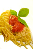 Italian spaghetti with basil and tomato sauce Stock Photography