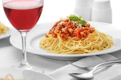 Italian spaghetti bolognese served with a glass of red wine Royalty Free Stock Images