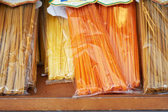 Italian spaghetti on counters of shops Stock Images