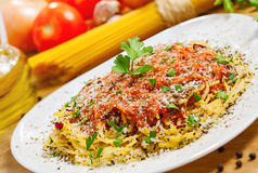 Italian spaghetti. Food, Pasta with sauce and parmesan cheese, ingredients on background Royalty Free Stock Photography