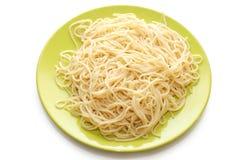 Italian spaghetti on green plate Stock Photo