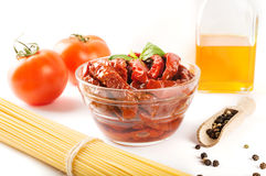 Italian spaghetti with ingredients for cooking pasta on a white background Stock Photography