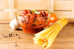 Italian spaghetti with ingredients for cooking pasta on a wooden table Stock Photography