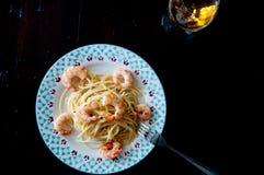 Italian spaghetti with lemon cream and shrimp Royalty Free Stock Photography