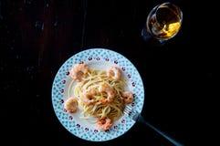 Italian spaghetti with lemon cream and shrimp Royalty Free Stock Images