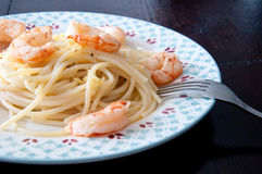 Italian spaghetti with lemon cream and shrimp Royalty Free Stock Photo