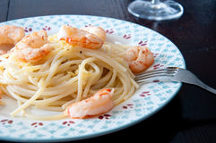 Italian spaghetti with lemon cream and shrimp Stock Photos