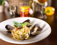 Italian spaghetti with mussels and basil Royalty Free Stock Photo