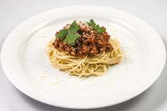 Italian spaghetti pasta with beef and tomato sauce bolognese. On white plate Royalty Free Stock Photo