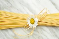 Italian spaghetti. Italian pasta spaghetti on carrara marble top Stock Image