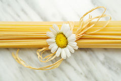 Italian spaghetti. Italian pasta spaghetti on carrara marble top Stock Photography