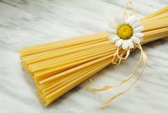 Italian spaghetti. Italian pasta spaghetti on carrara marble top Stock Photo