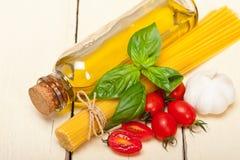 Italian spaghetti pasta tomato and basil Stock Photos