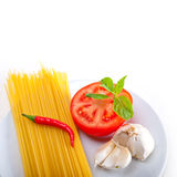 Italian spaghetti pasta tomato ingredients Royalty Free Stock Photography
