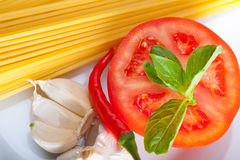 Italian spaghetti pasta tomato ingredients Stock Photography
