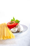 Italian spaghetti pasta tomato ingredients Royalty Free Stock Photos