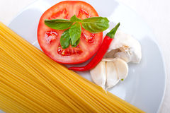Italian spaghetti pasta tomato ingredients Royalty Free Stock Image