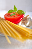 Italian spaghetti pasta tomato ingredients Stock Image