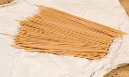 Italian spaghetti pasta on white paper and canvas stock photo