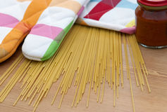 Italian spaghetti with potholder on the table Royalty Free Stock Image
