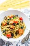 Italian spaghetti puttanesca pasta. Close up of homemade Italian spaghetti puttanesca pasta royalty free stock photography