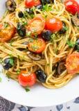 Italian spaghetti puttanesca pasta. Close up of homemade Italian spaghetti puttanesca pasta royalty free stock photo