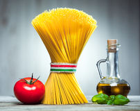 Italian spaghetti tied with a ribbon Royalty Free Stock Images