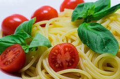 Italian spaghetti. With tomato and basil Royalty Free Stock Photography