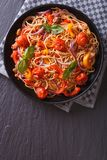 Italian spaghetti with vegetables vertical top view Royalty Free Stock Photo