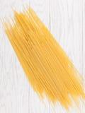 Italian spaghetti. On white wooden background Stock Images