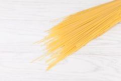Italian spaghetti. On white wooden background Royalty Free Stock Image