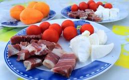 Italian specialties, prosciutto, mozzarella, tomatoes Stock Photos