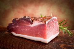 Italian speck. On chopping board stock photo