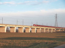 Italian speed train Frecciarossa crossing viaduct Stock Photography