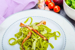 Italian spinach pasta with organic garlic Stock Image
