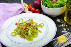 Italian spinach pasta with organic garlic Stock Photos