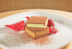 Italian spring dessert with cocoa cream and raspberries Royalty Free Stock Photos