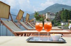 Italian Spritz cocktail against lake Como, Italy Royalty Free Stock Photo