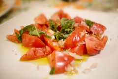 Italian starter of tomato and onion salad Stock Photography