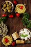 Italian still life - olives, mozzarella cheese, pasta Royalty Free Stock Image